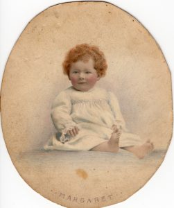 Lorna Rainbow, age 1. Hand tinted image — note the red hair. Lorna was known as Margaret, to distinguish her from her mother, who was also named Lorna
