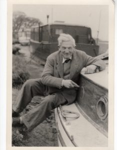 Ken Rainbow with his boat, in the 1950s